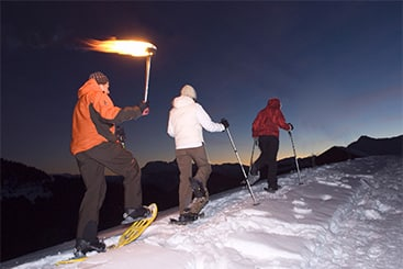 French holiday courses - snow shoeing at night